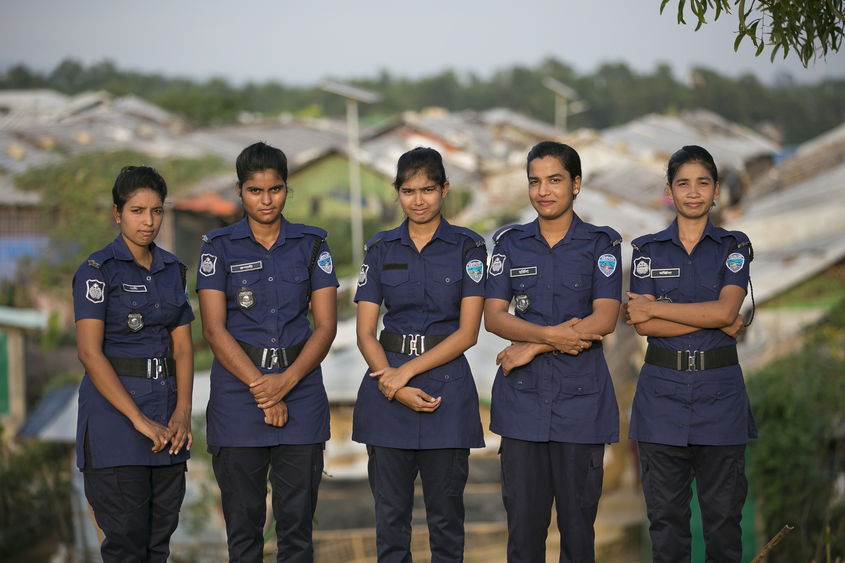 Bangladeshi police women Shati Akhter, Rupali Akhter, Mojina Begum, Mojina Akhter and Ruby Barua pose for photo at their duty station.The Women Help Desk deals most prominently with domestic violence, polygamy, rape and trafficking. The most surprising thing that the deal with is the level of domestic violence. {quote}Rohingya women have suffered so much and survived. We just want to make sure hey get their justice. that is our goal{quote}