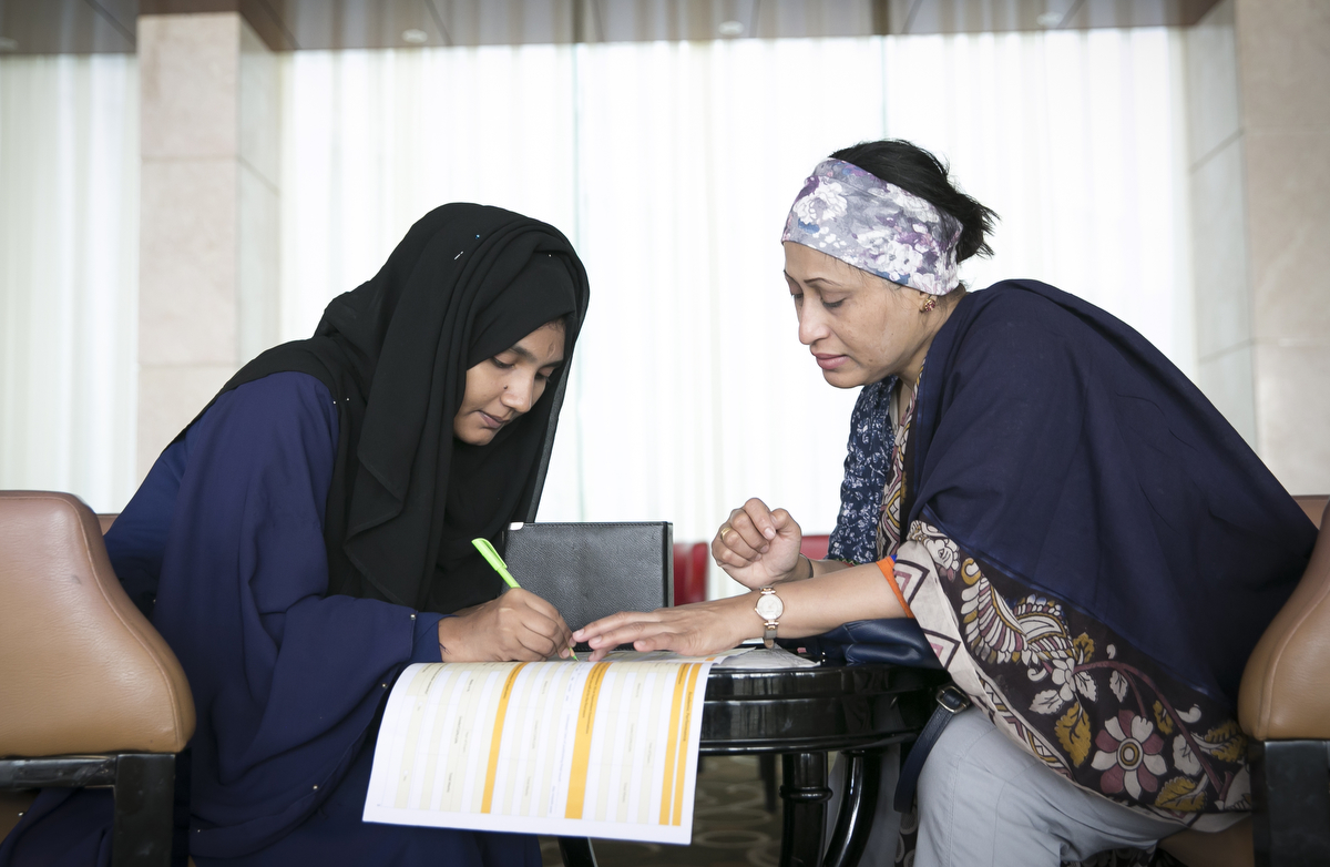 """Raze helps 18 year old Rohingya refugee Yasmin Akhter with her application to the Asian University for Women.Razia Sultana was born in Myanmar but is a Bangladesh citizen. She grew up in Chittagong in the tight knit Rohingya community. Her dream was always to be a barrister but after she was married her husbands family didn't approve of her studying further. {quote}My life is full of struggle{quote} She and her family were involved with the Rohingya activist groups ARNO and BRC, and in 2009 the Bangladesh government shut the organizations down. Two of her family members were put in jail and into exile abroad. {quote}The influx broke me totally. I was sick and traumatized and full of feat in my heart. I couldn't control myself. My friends and family asked me what I wanted and I said that I have to do something for women. That was the start. I gave up everything to work for my nation, to get them their rights, their human rights. What's been going on is wrong.{quote}  She has since trained hundreds of women in livelihood and literacy training. {quote}There is no life in the camps, they have become a burden for the world. If there is no skills training, no education, they will become subhumans! They're deprived of all opportunities and denied a normal life. They will become desperate and you can't blame them or anybody , it's like you're creating a bomb! They're frustrated and cant think wrong or right. We have to prevent this, we have to solve the issue of going back, you cant keep them in Bangladesh, this isn't their land."""""""