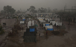 Rain falls over the Jhola relief camp.