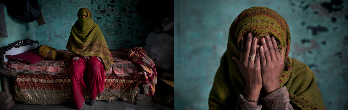 Alishba, 25, (whose name has been changed to protect her identity) covers her face while sitting for a photo, January 22, 2014 in the Shamli District of Uttar Pradesh, India. According to her, she was gang raped by two men during the riots on September 8, 2013. Four of her neighbors that she had known for 10 years broke down the door of her home, two guarded the door while the other two raped her. They released her when her mother-in-law heard the commotion and came down the stairs shouting that the police were on their way. Her and her husband filed a case with the police, but so far no arrests have been made. The police have offered her money to drop the case, and her rapists have threatened her family.