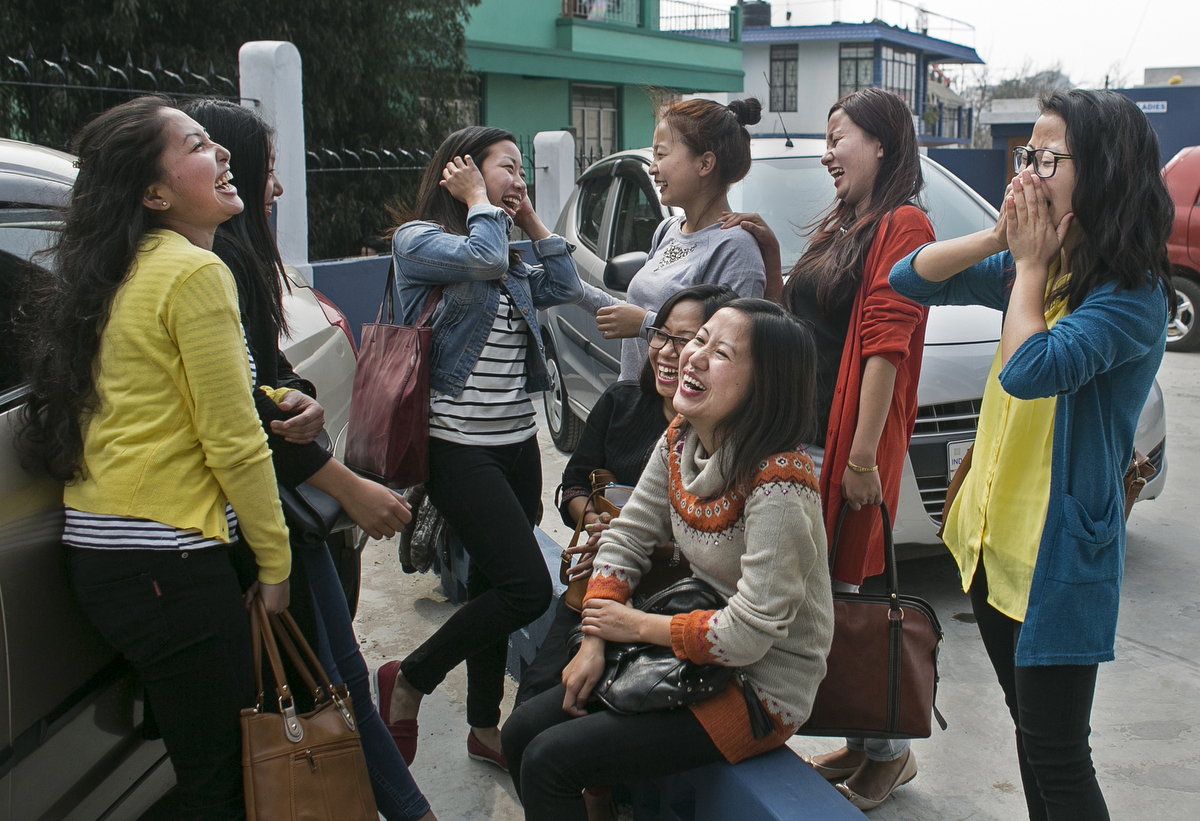 Girls hang out between classes at a university in Shillong