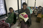 Dalariti looks on as her sister Asorphi holds her newborn daughter in the maternity ward of a hospital
