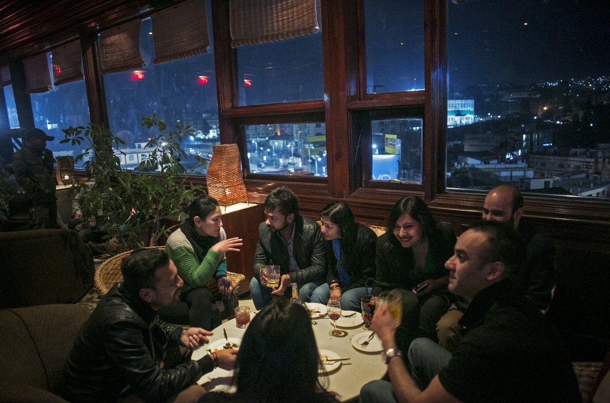 Men and women enjoy a night out at a bar in Shillong