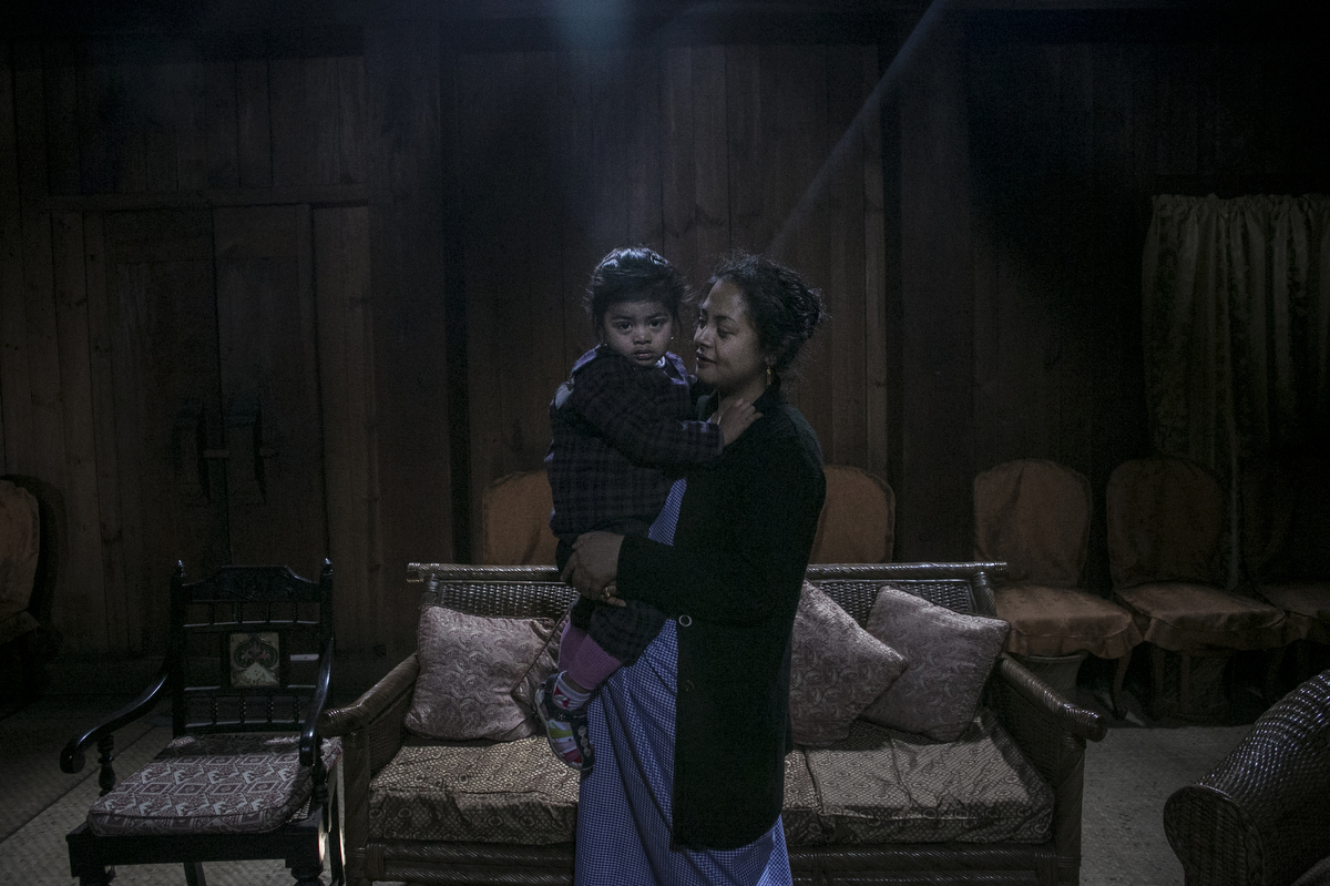 A Khasi princess holds her daughter in Shillong