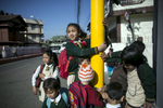 Girls wait for their school bus in Shillong