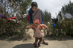 A woman plays with her daughter in a smal village outside Shillong