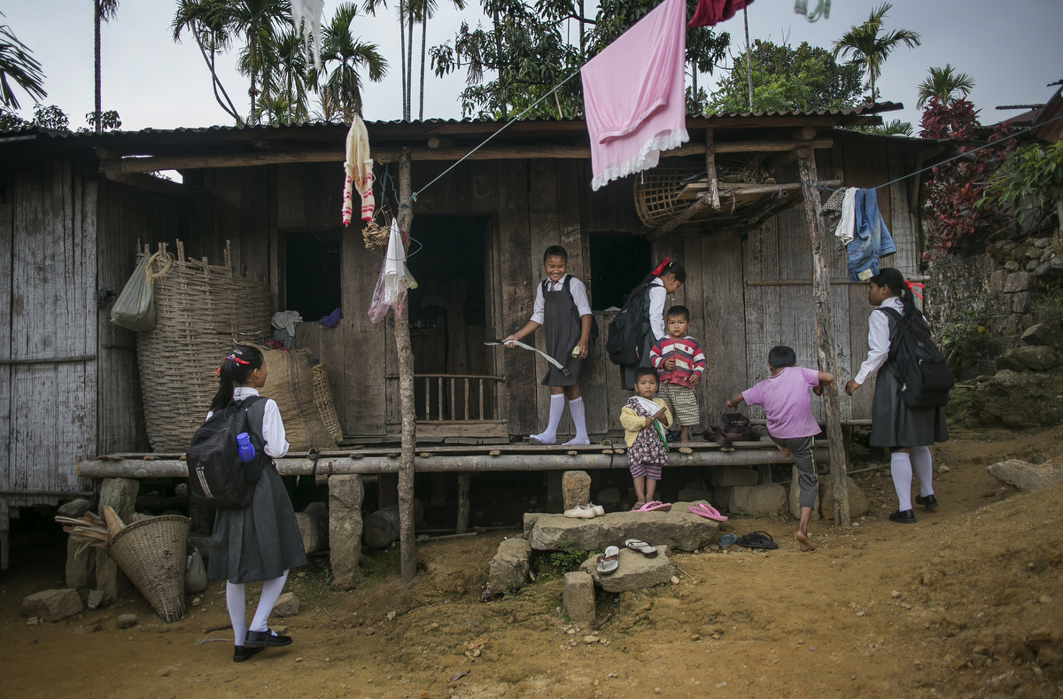 Girls come home from school in Dowki village