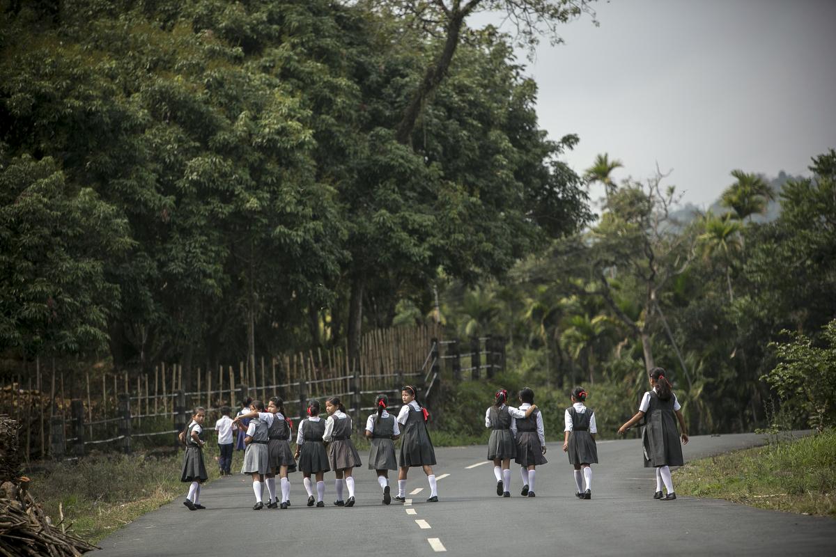 Girls walk home from school in Dowki village