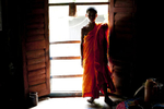13 year old Mong Sanu, who is training to become a monk, is seen inside his monastary before the Probarona Purnima festival in Ramu, Bangladesh. The Probarona Purnima festival celebrates the conclusion of the three-month long seclusion of the monks inside their monasteries for self-edification. Last year, on September 29th 2012 a muslim mob attacked and destroyed temples and homes of Buddhists after an anonymous person posted a photograph of a desecrated Quran on a local Buddhist boy's facebook wall. The community did not participate in Probarona Purnima last year in protest of the attacks.