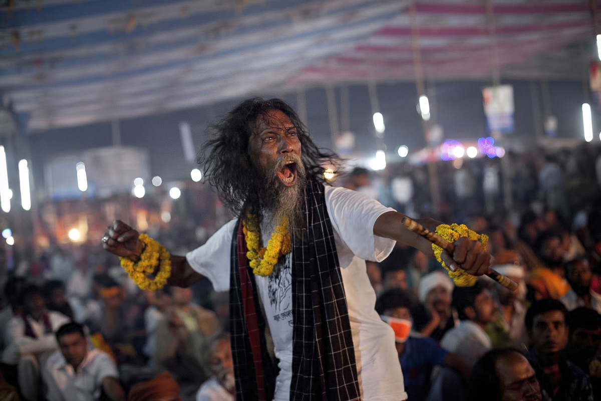 A festival goer dances during a live music event during the 124th annual Lalon festival in Kushtia, Bangladesh. The Lalon Shah festival is an annual festival celebrating the life and death of Fakir Lalon Shah, who was a Bangladeshi mystic, baul, philosopher, musician, writer and advocate of religious tolerance. Buddhists, Hindus and Muslims follow his teachings and attend the festival, which comprises of 3 days of music, dance, and consumption of marijuana, which is referred to as