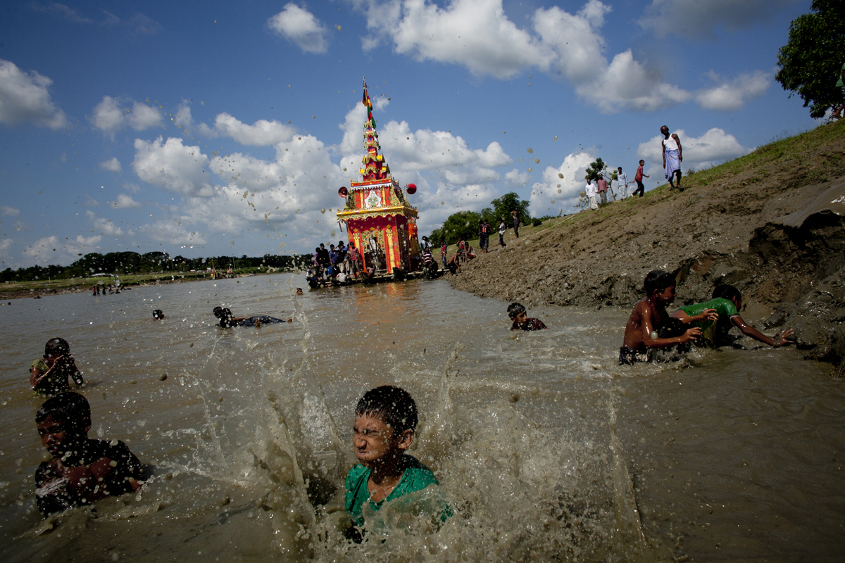 Bangladeshi Buddhists celebrate their annual boat festival during Probarona Purnima in Ramu, Bangladesh. The Probarona Purnima festival celebrates the conclusion of the three-month long seclusion of the monks inside their monasteries for self-edification. Last year, on September 29, 2012 a muslim mob attacked and destroyed temples and homes of Buddhists after an anonymous person posted a photograph of a desecrated Quran on a local Buddhist boy's facebook wall. The community did not participate in Probarona Purnima last year in protest of the attacks.