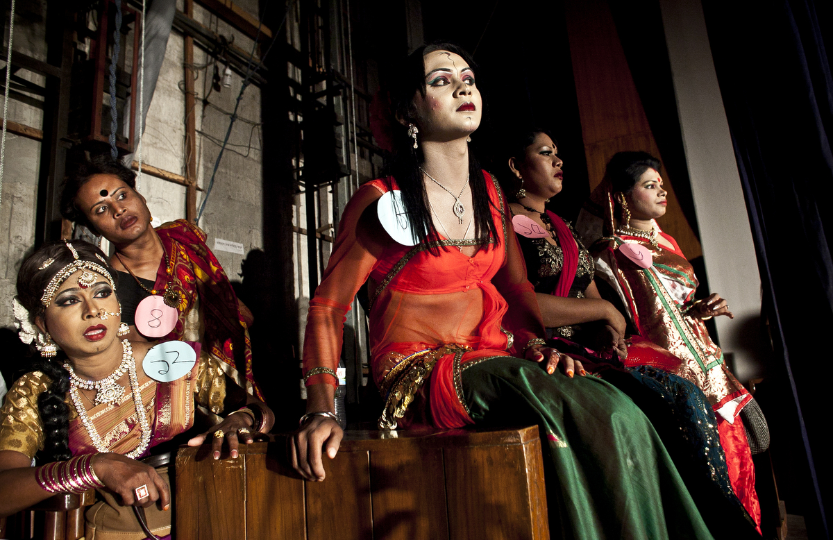 Hijras (transgenders) watch a performance backstage at the Hijra talent show, part of the first ever event called Hijra Pride 2014 in Dhaka, Bangladesh. In 2013 Bangladesh officially recognized Hijras as a third gender, though homosexuality still remains illegal. Despite these strides Hijras continue to face violence and harassment as part of their daily life in Bangladesh.