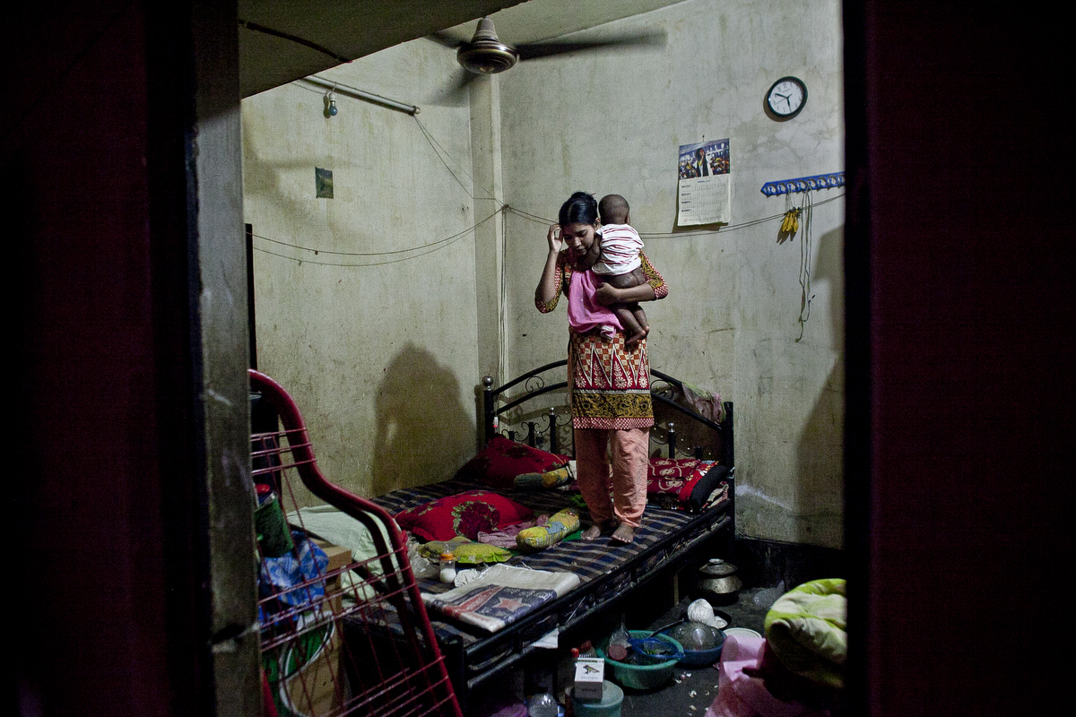 A garment worker in her home in Dhaka, Bangladesh