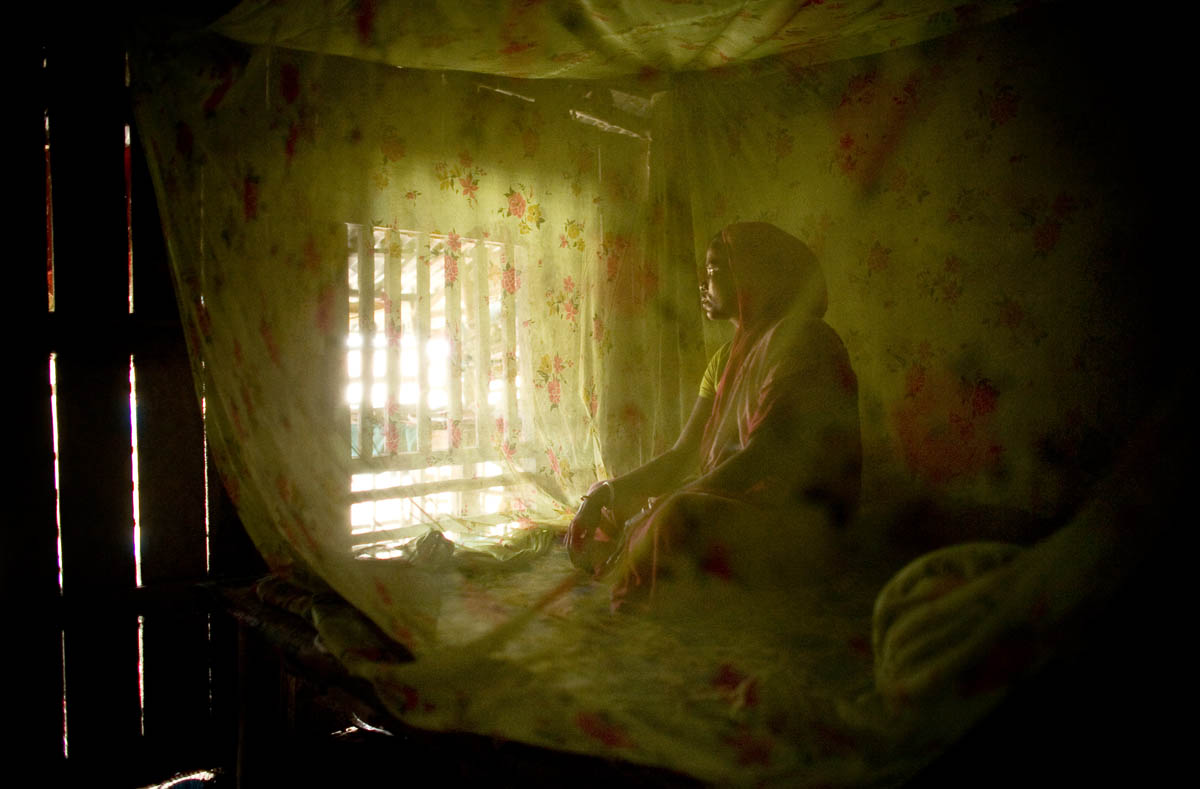 Nafeesa Begum sits inside her home in Sunderbans, Bangladesh.