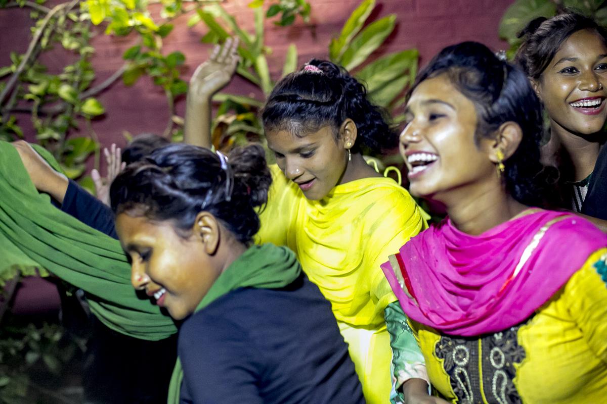 Johanara, Suma and Maysha dance during a surf club party