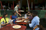 Sumi, Aisha, Rashed and other surf club members eat breakfast