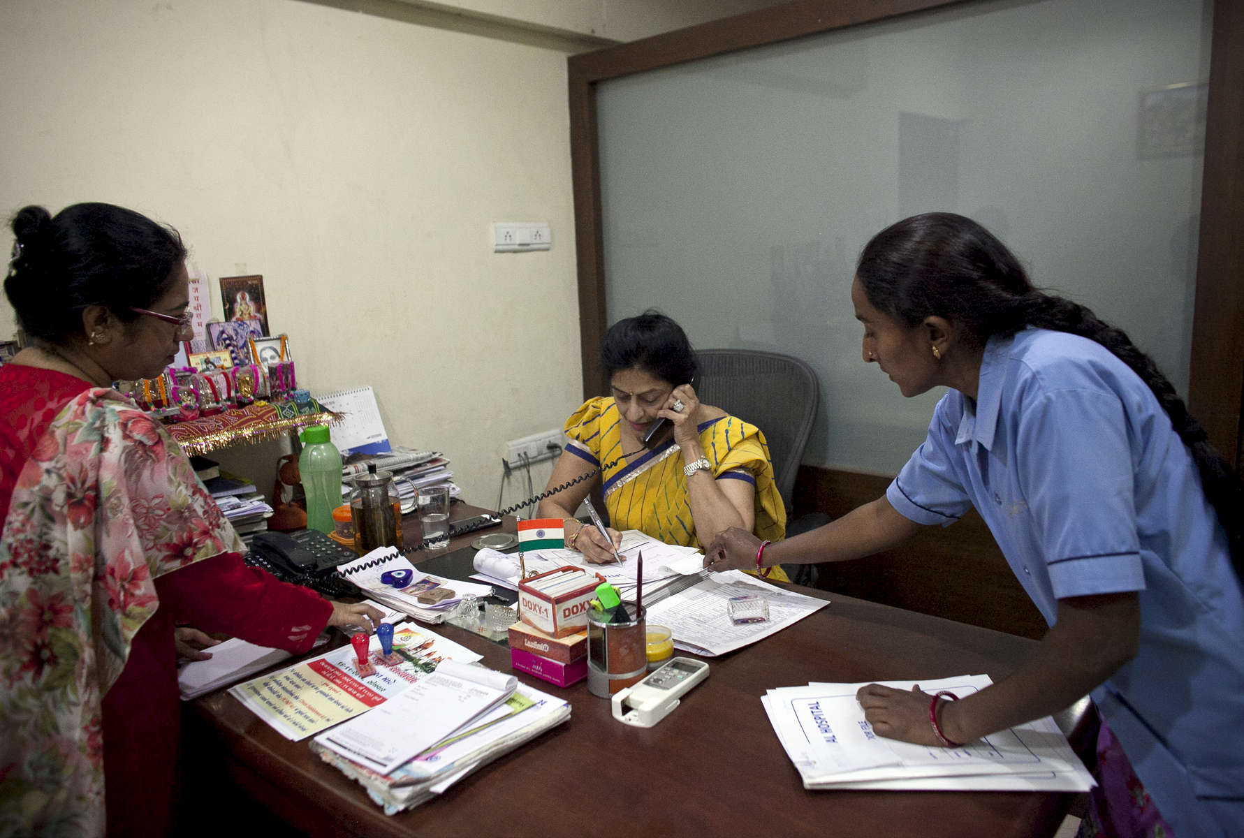 Dr. Nayna Patel works in her office