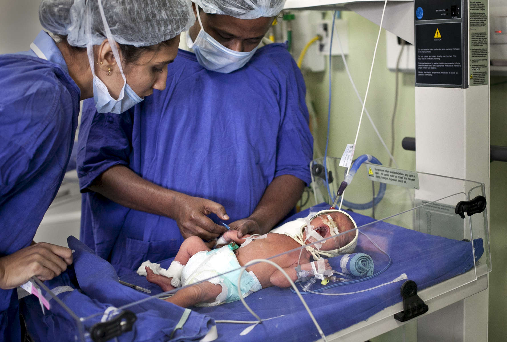 Newborn babies that were born at the Akanksha IVF center are looked after in the Neonatal Intensive Care Unit (NICU) of Zydus hospital.