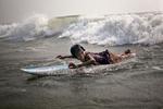 Johanara tries to catch a wave