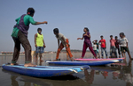 Rashed Alam teaches the girls to surf in in Cox's Bazar, Bangladesh.