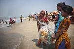 Johanara, Suma and Aisha sells items on the beach