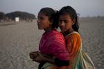 Suma and Shobe Mejerez embrace on the beach