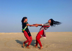 Rifa and Sumi dance on the beach