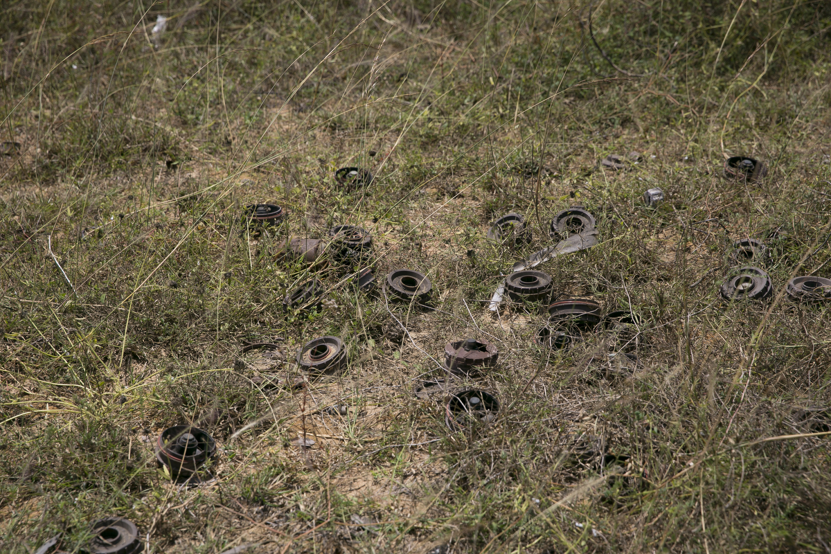 Discarded mines lay in a field in Muhamalai, one of the biggest minefields in the world