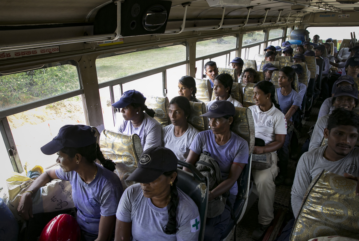 Female de-miners take the bus back to base after finishing a shift working at Muhamalai, one of the biggest minefields in the world