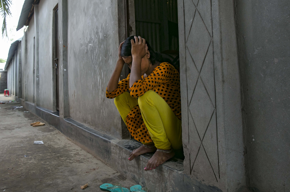 {quote}Samira{quote} waits for customers at a brothel.  She was married at 12 and trafficked to a brothel two weeks later.'I ran away from my husband after seven days. He was only about 15 or 16, but he raped me so violently that one morning, when I knew he was asleep, I slipped out of the house as quietly as I could, and ran. I left my shoes behind because I didn't want to wake anyone up. I was so scared about what would happen to me if I was caught.I ran back to my house, but I was too frightened to go inside because I was covered in blood and bruises. My mum died when I was 11, so my brother and sister had arranged the marriage because they couldn't afford to look after me any more, and I knew leaving my husband would make them angry. So I asked a rickshaw driver to take me across {town} to my friend's house – but he told me I should be ashamed of myself, and dropped me off at the brothel instead. I didn't understand where I was. I just saw all of these women wearing weird make up and strange clothes. But I didn't have anywhere else to go, so I stayed. When they told me I needed to sleep with men for money, I figured it didn't matter. I'd already been raped. I might as well get paid for it.Sometimes I feel like it was my choice to end up here, because I'm the one who ran away. And I'm the one who didn't leave. But I don't understand how I could feel so unhappy if it was my decision. The pimps taught me how to have sex so that it wouldn't be so painful, but my whole body still aches all the time. Even I ask the customers to be gentle with me, it hurts so much that I can't help crying out. I can't remember the last time I didn't cry at night. Mostly, I cry because I miss my mum.'