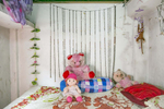 The room of {quote}S{quote} is seen at a brothel. She was married at 14 and came to the brothel at 15.'My favourite thing in the world is my doll, Mimi. My mother bought her for me on Valentines Day this year. I used to have so many more dolls and teddies – like, what you can see here is nothing. My childhood was perfect. I wish I could goback in time and be a kid again. That's definitely why I still have so many toys. It helps me pretend none of this is happening to me. My mum knows I work here, and she hates it, but there's no alternative right now. She used to be a sex worker when she was my age too, so she understands how bad it is. But she also knows that sometimes, girls don't get a choice. When I was 12, my father and brother died, and I went to stay with a new family to work as a maid. One of the sons would torture me – tying me up and raping me again and again and again. When I escaped and ran back to my mum, it wastoo late; I was already pregnant. Abortions are easy to arrange here, but afterwards, the only option is to get married to whoever will take you. The only man who would take me was a gambler who lost all the dowry in a bet. After the ceremony, he started torturing me so that my mum would agree to pay more in exchange for my safety – but she didn't have any money. I think that was the moment when I knew I'd have to come here. I thought, 'my life is already ruined – at least this way, I'll be able to support myself.' So I asked for a divorce, and took a rickshaw to the brothel. That was a year and four months ago – and I've regretted it every day since.'