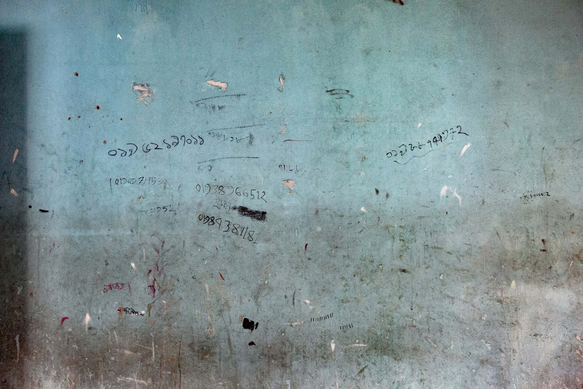 Customers phones numbers are written on the wall