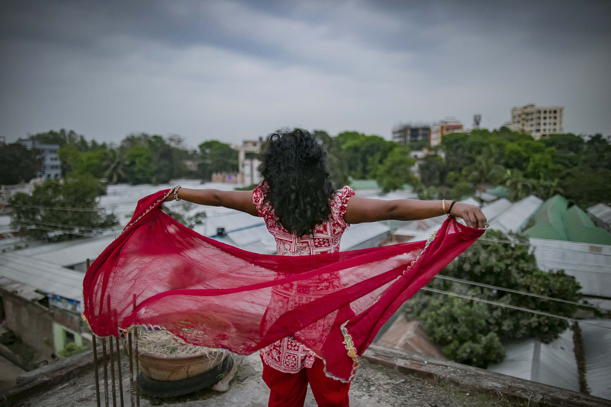 A trafficking victim, who was trafficked into the brothel when she was 14 years old, overlooks a brothel in Bangladesh