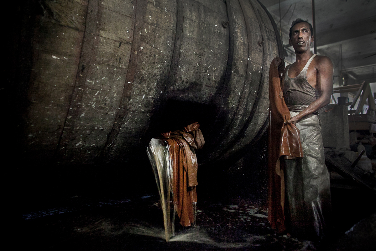 40 year old Sharjahan unloads leather hides from a vat of chemical mixture in a tannery, the Phoenix Leather Complex.