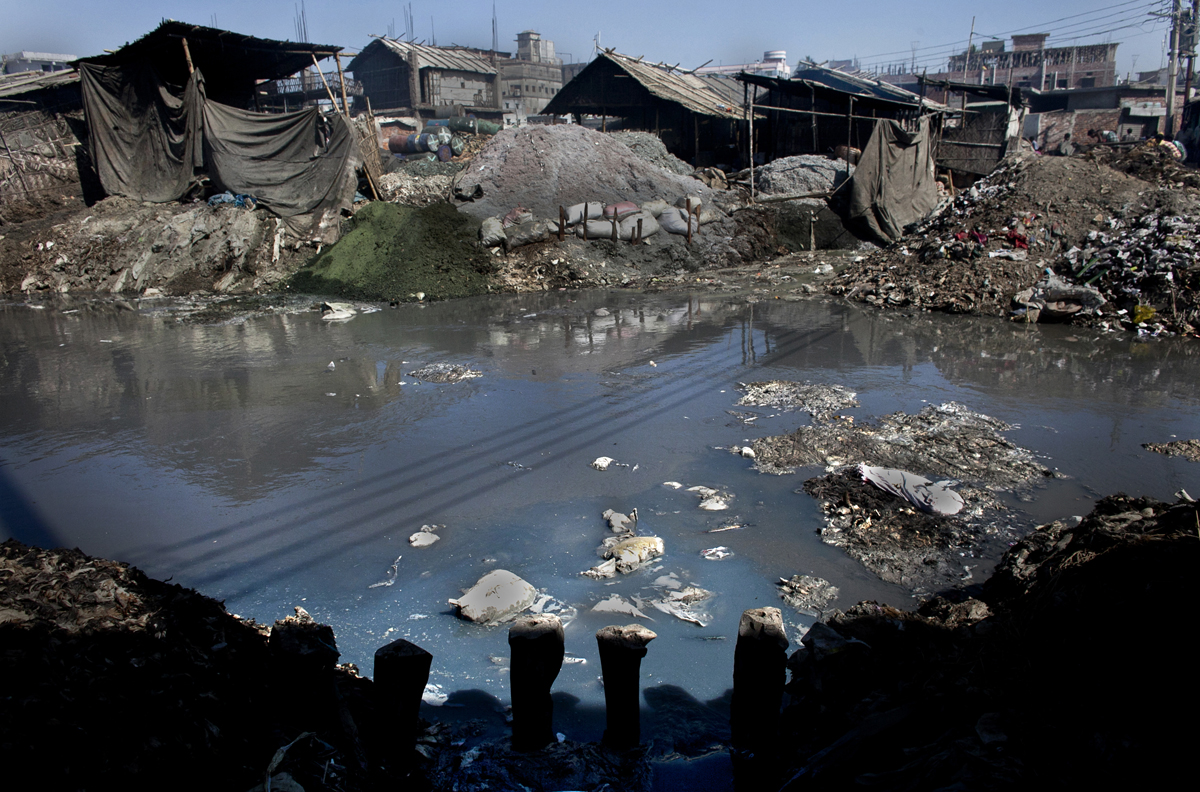 Blue colored dye and chemicals are emptied out of a leather tannery and into a canal that empties out into the Buriganga river.