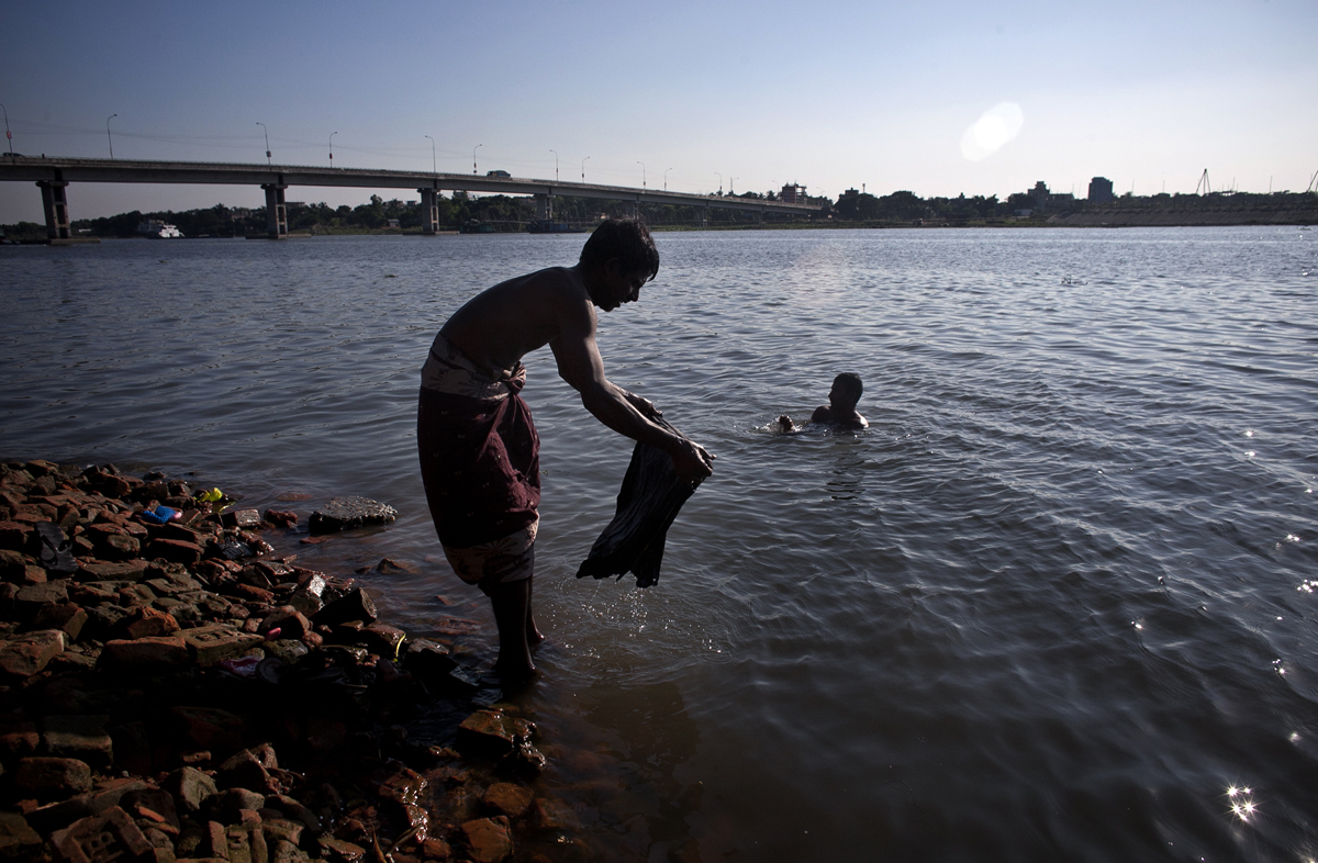 Men bathe in the Buriganga river.