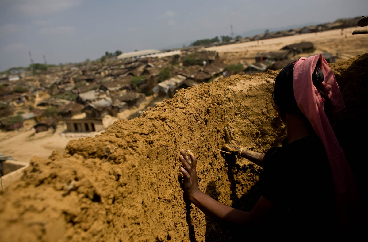 A Rohingya girl builds a mud wall at an unregistered refugee camp at Kutupalong near Cox's Bazar, a southern coastal district about 300 kilometers south of Dhaka, Bangladesh. Hundreds of thousands of members of the Rohingya ethnic group have fled to Bangladesh to escape persecution in neighboring Myanmar only find themselves trapped in international limbo. As Muslims, they were unwanted in Buddhist Myanmar and as foreigners, they are unwanted in Muslim Bangladesh.