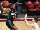 Coastal Carolina guard Josh Cameron (3) catches a pass from a teammate as Liberty Flames guard/forward Ryan Kemrite (5) looks on during a game against Coastal Carolina Saturday night.
