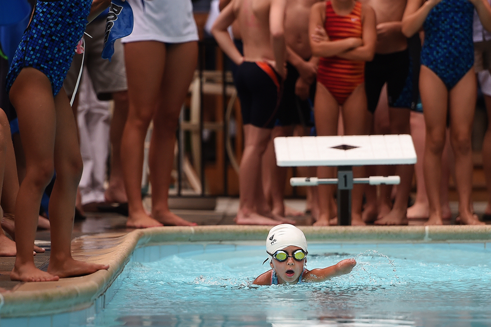 Madelyn Rebsamen, 6, competes in the Lynchburg Aquatics League meet at the Hill City Swim and Tennis Club Monday night. Despite being affected by Amniotic Band Syndrome, which caused her to be born without a full left arm, Madelyn competes in a variety of sports, including soccer with Central Virginia United.