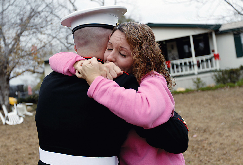 Pfc. Jason Barfield, a United States Marine, embraces his mother, Kelli Barfield, outside her home in Ashford Wednesday morning, December 16, 2010. Pfc. Barfield surprised his mother, who thought he wouldn't be home for Christmas, with the visit. On October 24, 2011, Barfield died while conducting combat operations in Helmand province, Afghanistan. On March 7, 2013, he was posthumously awarded the Bronze Star for heroism in combat.