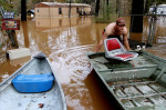 Ricky Catrett loads a boat onto a trailer Tuesday afternoon Dec. 15, 2009 after retrieving items from his flooded home in Level Plains. Heavy rains covered roads with floodwaters, prompting several rescues and forced educators to close schools Tuesday in parts of south Alabama, with as much as 10 inches of rain falling in a few hours. (AP Photo/Dothan Eagle, Max Oden)