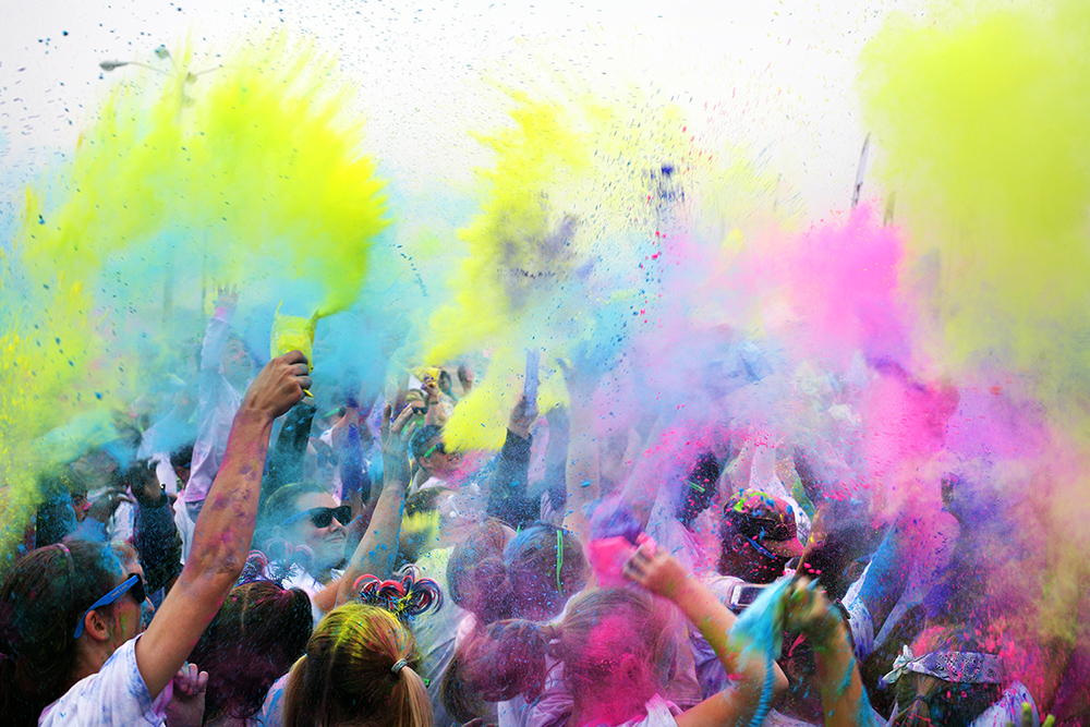 Runners participate in a party with colored powder following the conclusion of the Color Vibe 5K in Montgomery, Ala.