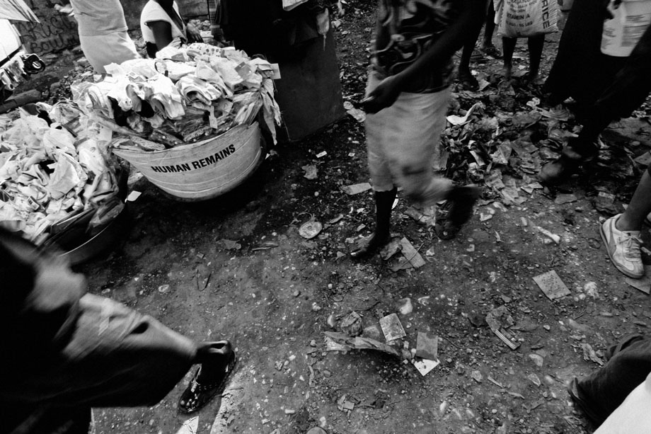 People walk by a repurposed human remains container at a market in Port-au-Prince, Haiti in early February 2010.