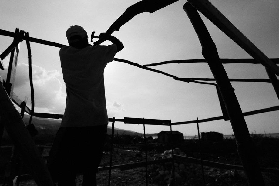 A man, whose home was destroyed by the January 12, 2010 earthquake, works to build a new home on a beach outside of Port-au-Prince, Haiti in early February 2010.