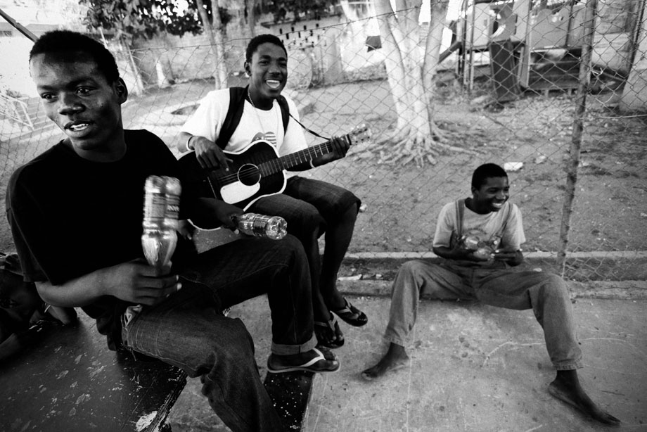 Young residents of an orphanage perform worship songs to pass time in early February 2010.