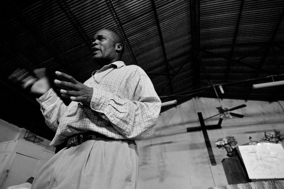 The pastor of a church in Carrefour, Haiti shares a message of hope with his congregation in early February 2010.