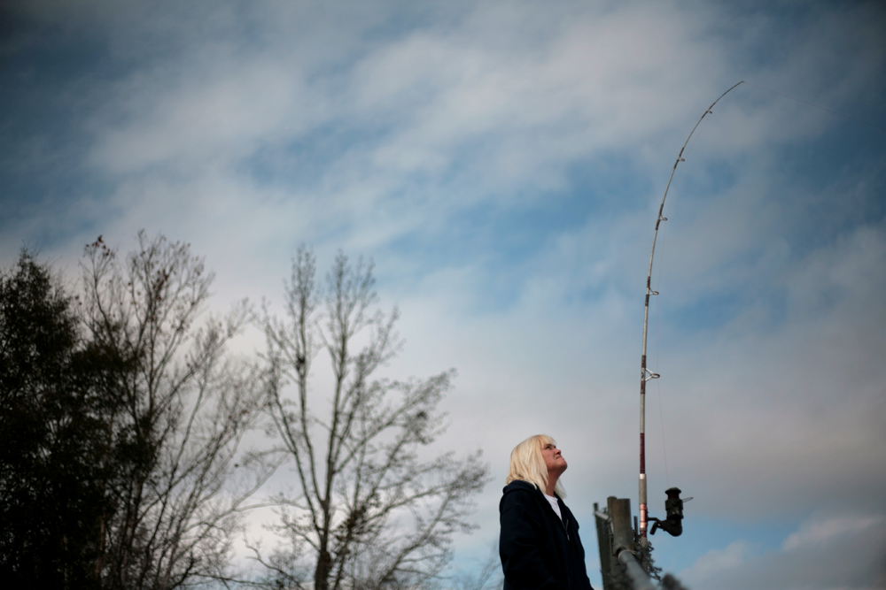 Webb, Ala. resident Robyn Scearce fishes from a concrete structure near the Columbia Reservoir on the Chattahoochee River January 21, 2011.