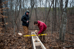Kevin Ferrell and Isaac Schumacher work to mill a tree in early February.