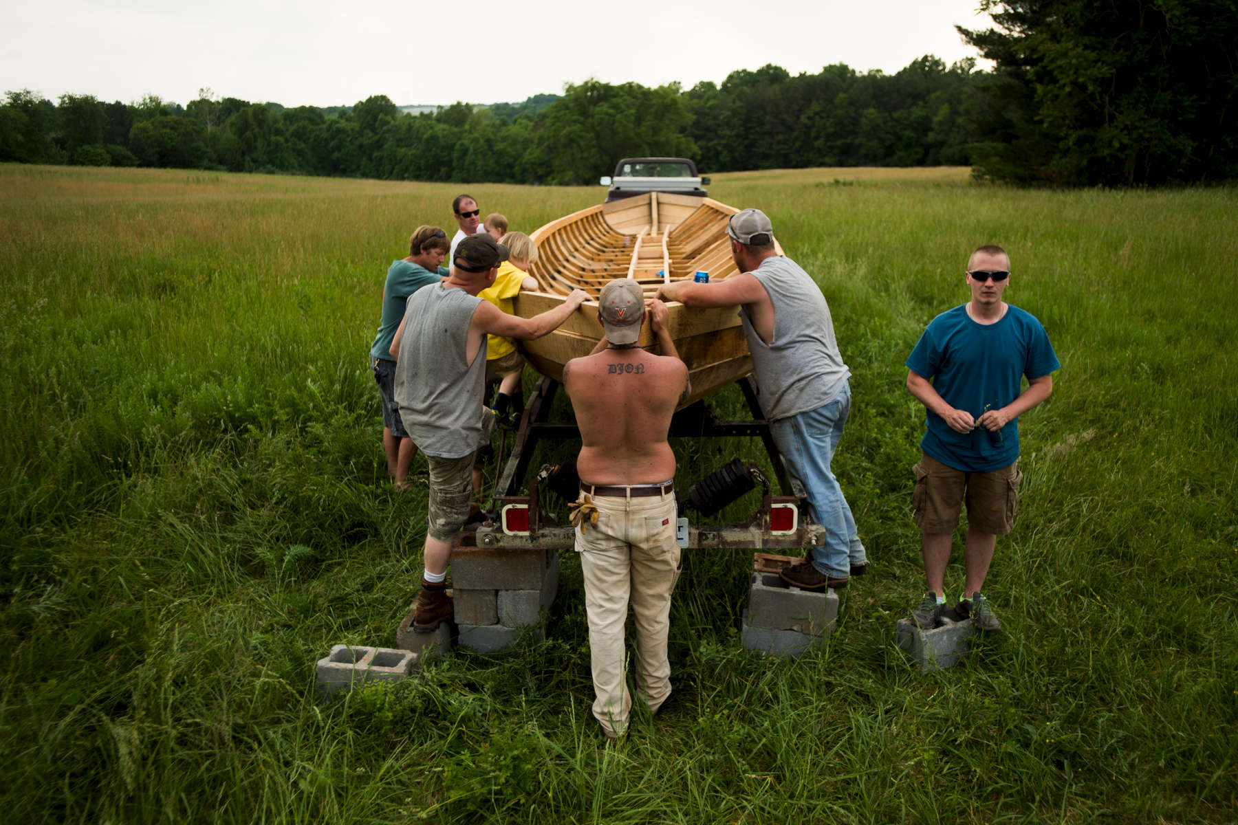 Members of the local batteau community came together to flip the Lizzie Langley over and load her onto a trailer for transportation to the James River.