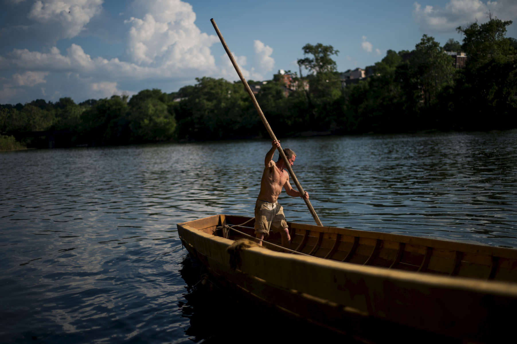 Robert Schumacher uses a pole to guide the Lizzie Langley into the James River for the first time on May 18.